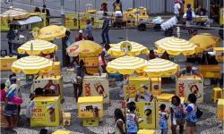 Ambev oferece auxílio de até R$ 255 para ambulante que não vai trabalhar no carnaval; veja como se cadastrar